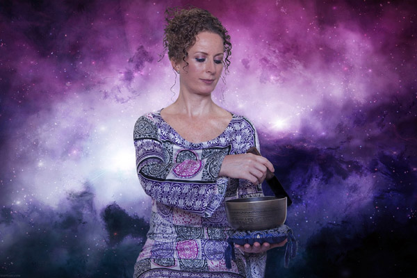 A spiritual looking woman mixes something in an ornate pot