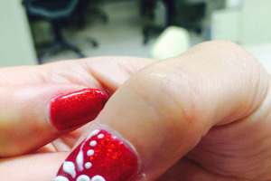 Sparkling gems and carefully detailed 3D floral images provide a stunning look from Binh's Nails in South Edmonton