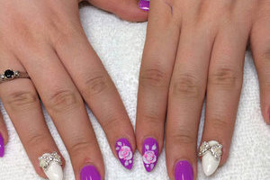 Beautiful hands with almond-shaped nails, unique colour and artistic elements for each nail and 3D touches; available at Edmonton manicure salon Binh's