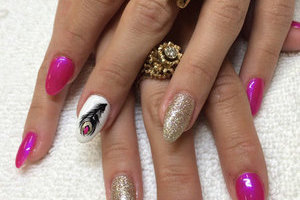 Womanly hands withalmond-sculpted nails in plain pink, white with feather motif and silver glitter from Binh's manicure salon in Edmonton