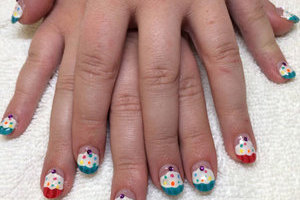 Oval nais are a great choice to jazz up with fun designs from Binh's Nails
