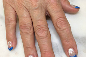 Oval nails with cameo-blue tips and matching white highlights are a beautiful creation of Binh's Nails on 17 Street.