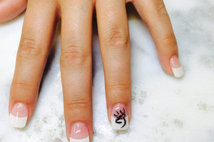 Manicure with French tips and elk-motif line art from Binh's in Edmonton