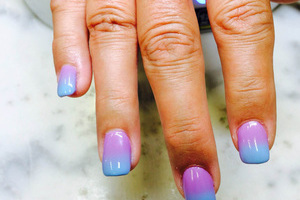 Manicured fingers in subtle hues are yours from binh's nail crafters