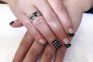 Attractive hands featuring squared nails with black and white design elements from Binh's Nails