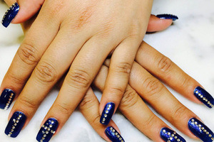 Deep purple polish highlighted with bling is a unique look from Binh's