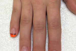 female fingernails polished clear with orange and black highlight elements from Binh's