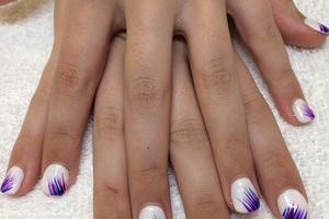 Pure white polished nails are set off by purple lash adornments from binh's