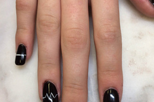 Heart monitor line art against a black background is a stunning look from Binh's Nails
