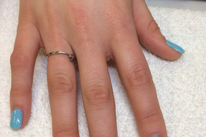 Robin's egg blue nail polish adorns these fingernails with the ring finger featuring a colour matched stripes