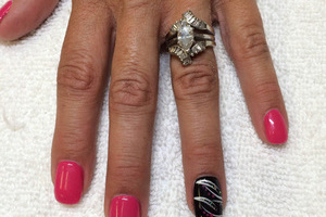 Pink polished fingernails with a featured finger in black and silver from Binh's