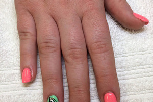 Pink polished fingernails are contrasted by pistachio polish on the ring fingers in this attractive Binh's salon style