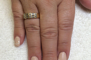 Fingers polished with off-white and a white line flourish is an attractive design at Binh's