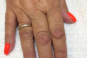 Orange nail polish with a hand-drawn artistic element is a great look from Binh's