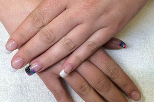A stylish manicure with black highlights from Binh's manicure salon.