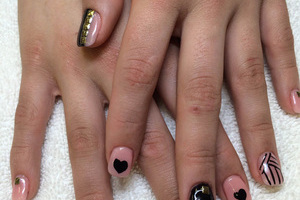 Crossed female hands with 3 different nail designs are a trending look at Binh's Nail Salon