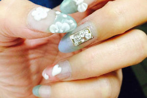 Perflectly manicured nails with 3D floral and heart-shaped elements