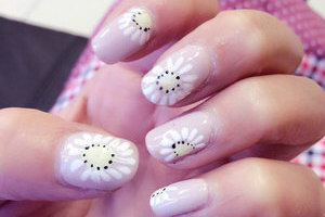 Pink fingernails with flowery adornments puts the merry in your mani at Binh's Nails in Edmonton